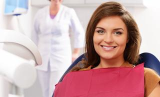 a woman smiles in the dental chair | chattanooga dentist