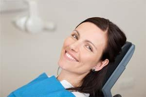 a woman smiles in the dental chair | Chattanooga tn emergency dentist