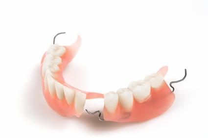 a denture on a white backdrop | east brainerd dentures