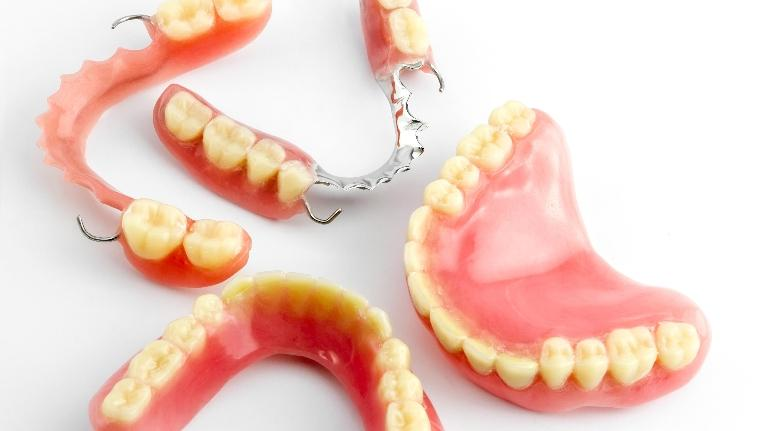 an image of various dentures on a white background | dentures east brainerd tn